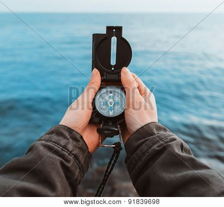 Tourist With A Compass On Coast