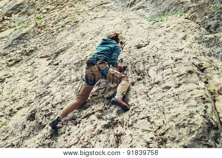 Active Woman Climbing On Rock