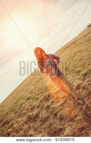 Beautiful Girl Walking On Summer Meadow