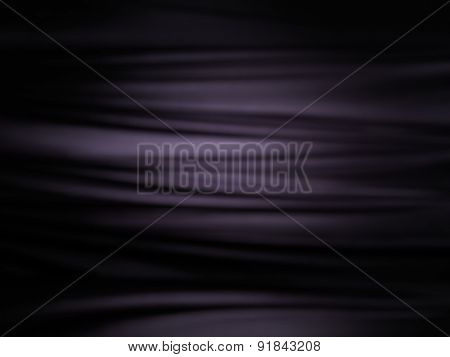 Abstract black shiny silky fabric folds background texture