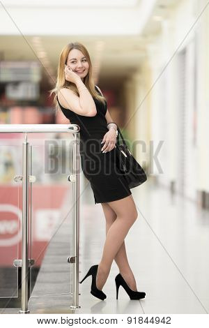 Young Woman On Phone In Shopping Center
