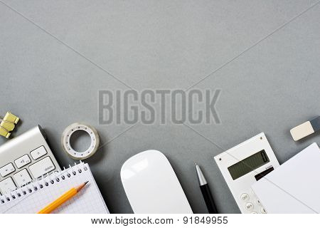 Keyboard, Mouse And Office Supplies On Grey Desk