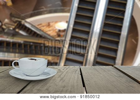 Defocus With Terrace Wood And Cappuccino Coffee With Escalators