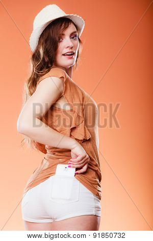 Summer Woman With Mobile Phone In Pocket.