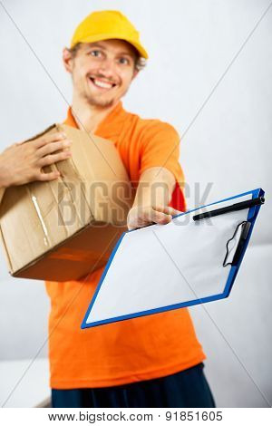 Parcel deliveryman with a blank
