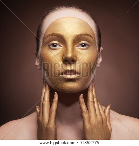 Woman With Fashion Art Make Up On Brown Background