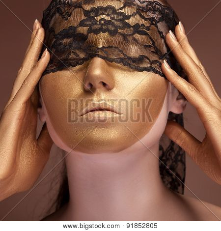 Woman With A Gold Fashion Face And Lace