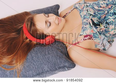 Young woman with red headphones