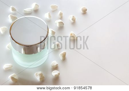 Cream Jar Closed On Glass Table Isolated