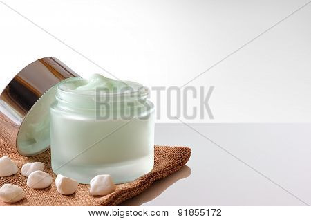 Cream Jar Open On Burlap Front Isolated