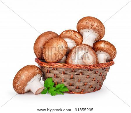 Brown Mushrooms In A Basket Isolated White Background