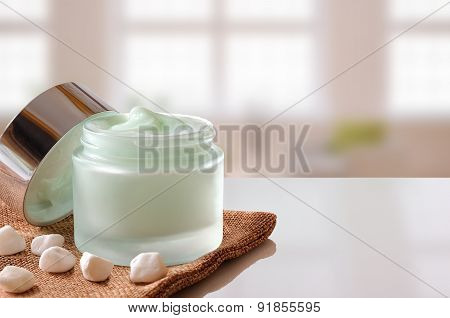 Cream Jar Open On Burlap Windows Background