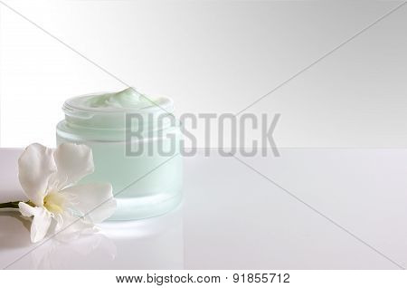 Cream Jar Open With Flower Front View White Isolated