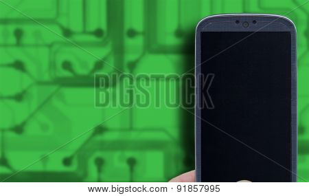 Smartphone and green technology background. Idea for telecommunication, digital detox, environment app, accessing apps, Internet, blogs and others.