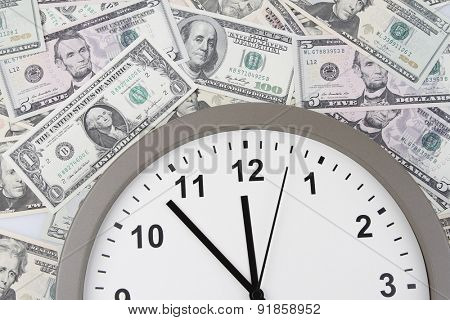 Clock on assorted American banknotes