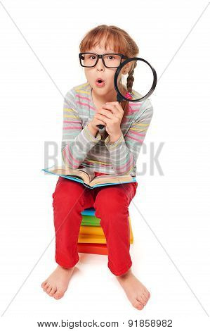 Little girl sitting on floor with a lot of books