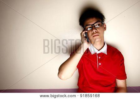 Teenage kid talking on a smartphone