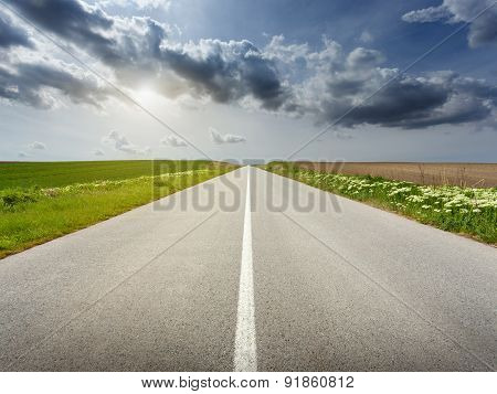 Driving On An Empty  Road At Idyllic Sunny Day