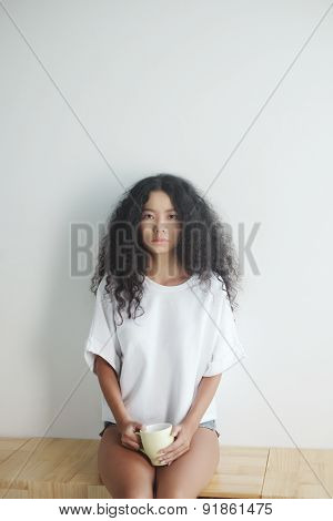 Unsmiling young woman