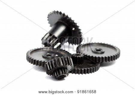 Plastic Gears Of Different Sizes On A White Background