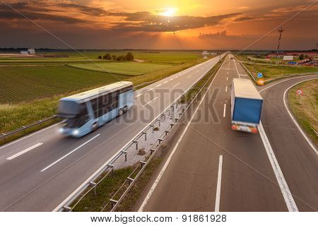 Truck And Bus In Motion Blur On The Highway At Sunset