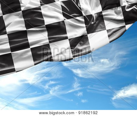 Checkered flag on a beautiful day background