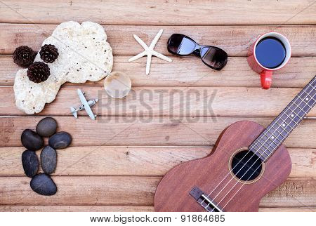 Cup Of Coffee And Ukulele On Wooden Background