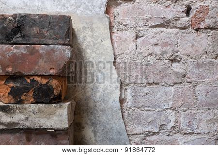 Stack Of Bricks Next To Partially Removed Wall Plaster - Background