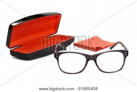 Eyeglasses in the gray frame case and velvet ribbon on a white background