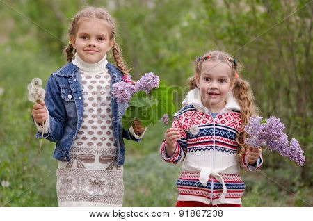 Two Girls With Dandelions And Lilacs