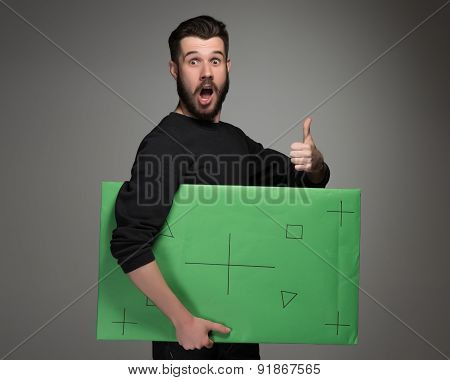 The smiling man as businessman with green panel