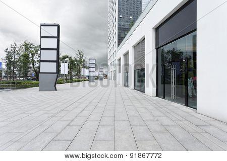 Empty road and building facade