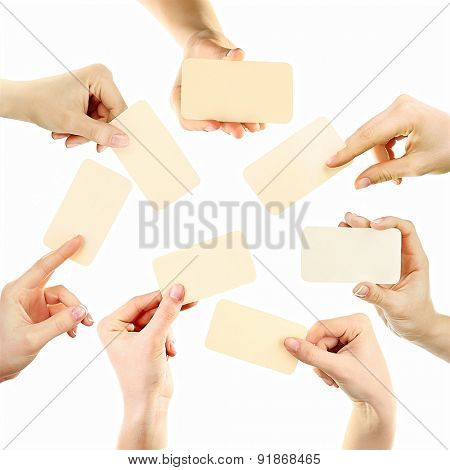 Collage of hands holding business card, isolated on white