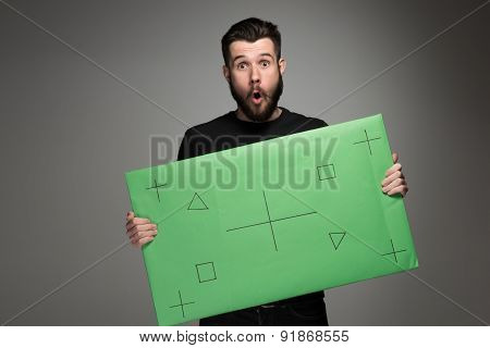 The surprised man as businessman with green panel
