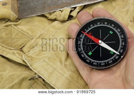 Male Hand With Compass And Machete On The Backpack