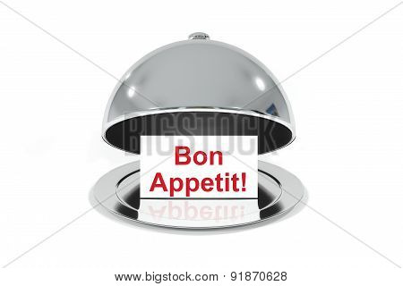 Opened Silver Cloche With White Sign Bon Appetit