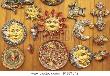 Colorful sicilian ceramics on a wooden surface