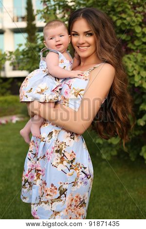Like Mother Like Daughter. Beautiful Family In Similar Dresses