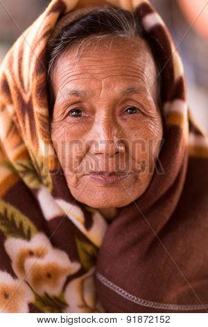 MANDALAY, MYANMAR, JANUARY 22, 2015: Portrait of a Burmese woman, passenger of the slow boat from Mandalay to Bagan in Myanmar (Burma)