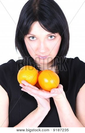 Young Beautiful Woman With Oranges