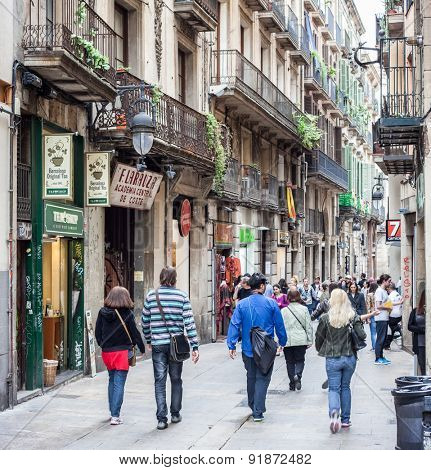 BARCELONA, SPAIN - APRIL, 2015: People strolling in Gothic Quarter in Barcelona