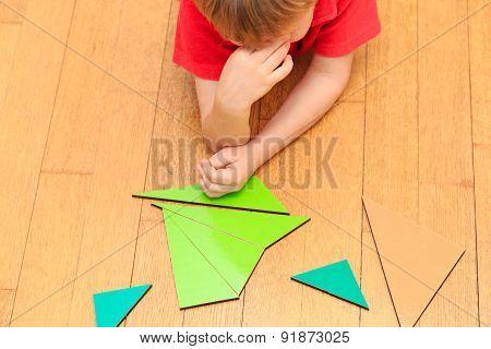 Brainstorm. Thoughts. Little boy solving math problem