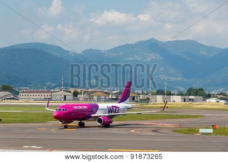 Aircraft Wizz Air Aviation Company At The Airport Of Bergamo.