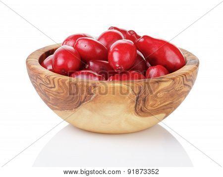 fresh bogwood berries in wood bowl isolated on white