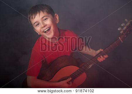 Happy Singing Boy With Guitar