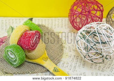 Colorful Jelly Rolls On A Decoupage Wooden Spoon