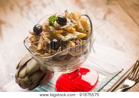 pasta with artichoke and black olives, selective focus