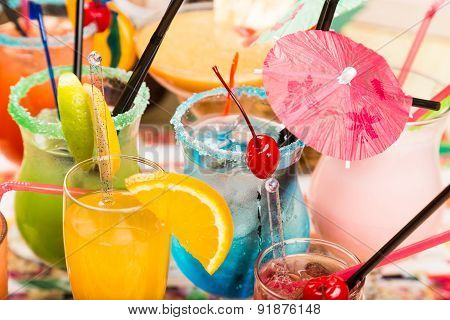 Different Fresh Cocktails With Ice In Glasses With Drinking Straw And Umbrellas