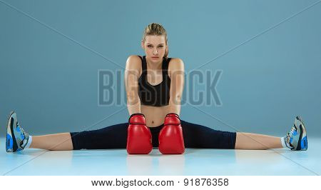 beautiful boxer girl on gray background
