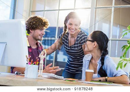 Smiling partners discussing together in the office